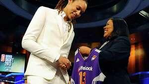 Phoenix-bound Brittney Griner, left, is greeted by WNBA president Laurel J. Richie.