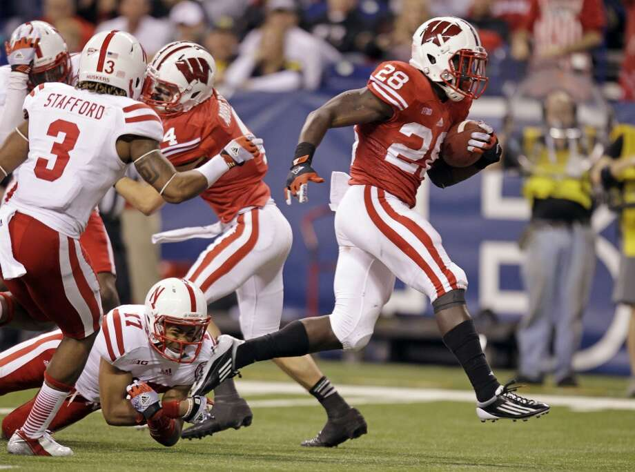 Montee Ball, 5-11, 214, 4.56, Wisconsin If he had come out a year ago, he would have been a first-round pick. He's the NCAA career touchdown leader. He works hard, has good vision and balance. When he hits the hole, he has terrific acceleration. Breaks tackles in the open field. Lacks great speed and has a lot of wear and tear on his tires. Should go in the second round.
