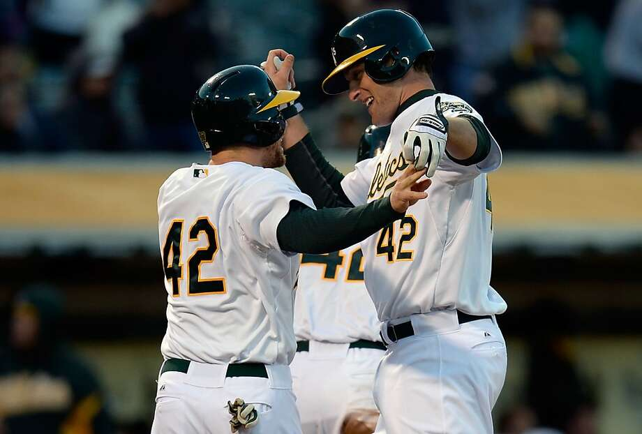 Nate Freiman (right) is greeted by Brandon Moss after Freiman's first major-league homer. Photo: Thearon W. Henderson, Getty Images