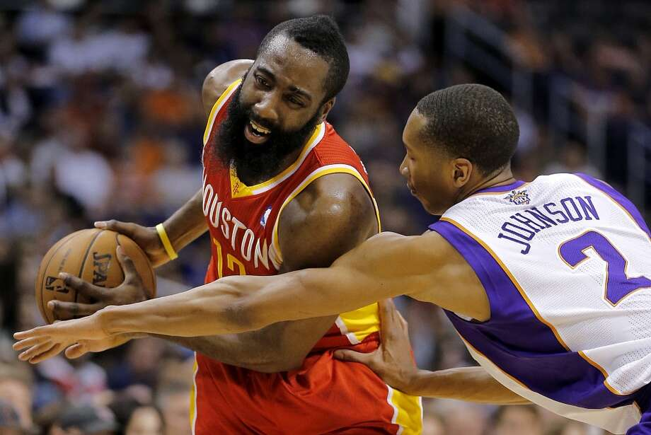 James Harden (12) protects the ball as Wesley Johnson (2) reaches. Photo: Matt York, Associated Press