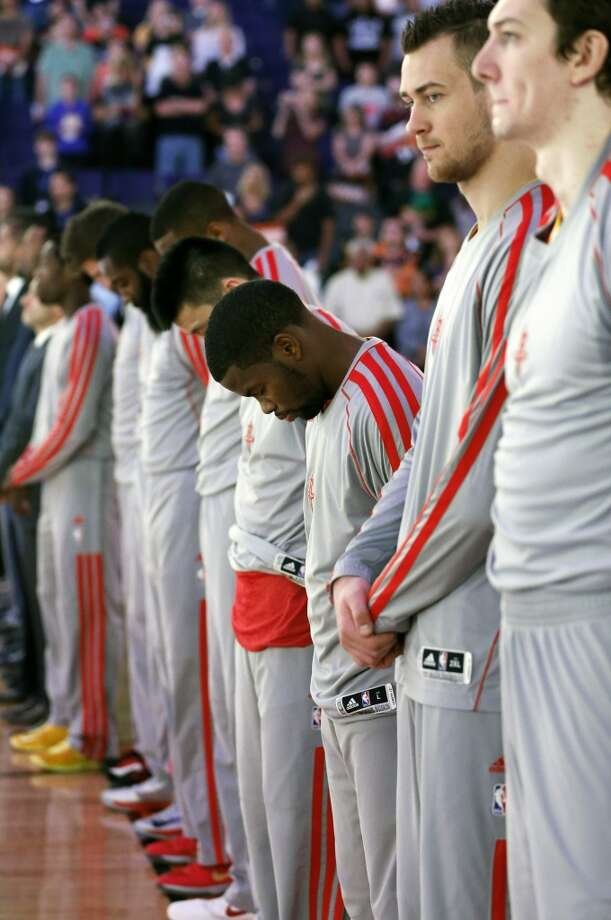 Rockets players observe a moment of silence for the victims of the Boston Marathon explosions. Photo: Matt York, Associated Press