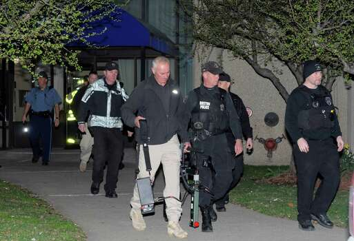 REVERE, MA - APRIL 15: Police and federal officials exit an apartment complex at 364 Ocean Avenue with a possible connection to the earlier expolsions during the Boston Marathon on April 15, 2013 in Revere, Massachusetts. Three people are confirmed dead and at least 141 injured after two explosions went off near the finish line to the marathon. Photo: Darren McCollester, Getty Images / 2013 Getty Images