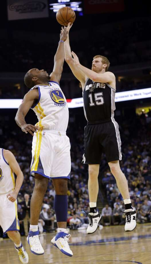 San Antonio Spurs' Matt Bonner (15) shoots over Golden State Warriors' Carl Landry (7) during the first half of an NBA basketball game in Oakland, Calif., Monday, April 15, 2013. (AP Photo/Marcio Jose Sanchez)