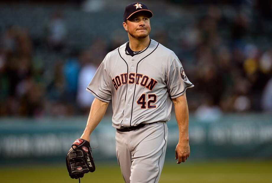 Eric Bedard of the Astros walks back to the dugout after giving up six runs and being taken out of the game against the Athletics in the first inning. Photo: Thearon W. Henderson, Getty Images
