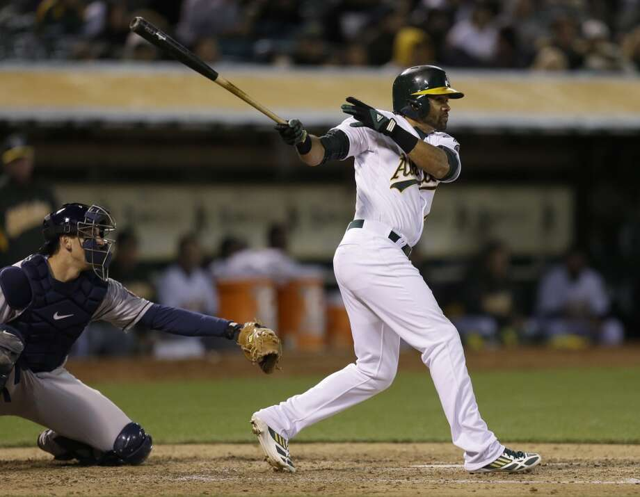 Coco Crisp swings for a double against the Astros in the fifth inning.