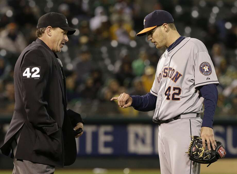 Astros pitcher Paul Clemens displays his finger to home plate umpire Paul Emmel in the sixth inning. Photo: Ben Margot, Associated Press
