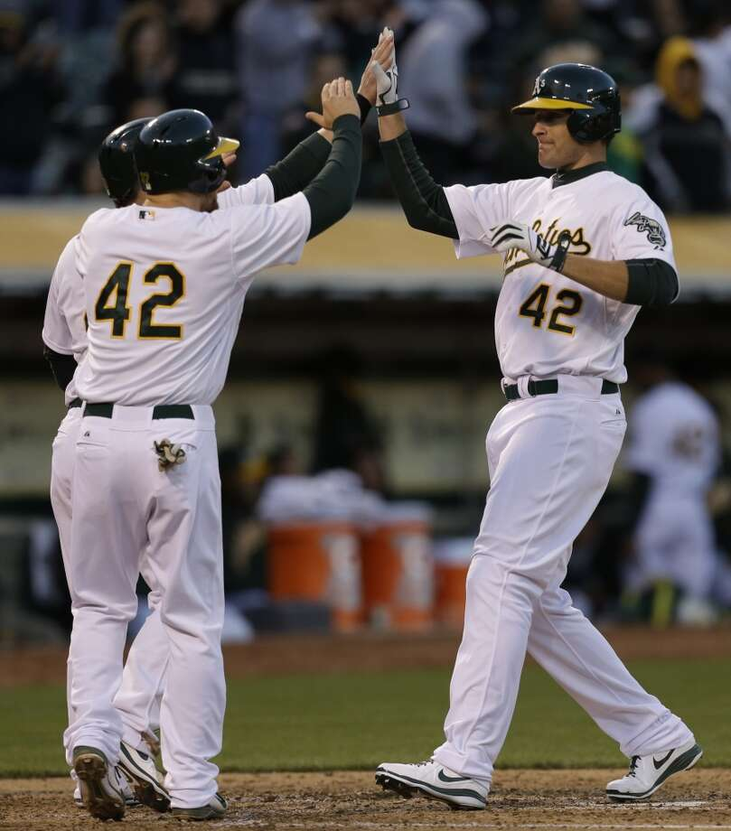 Nate Freiman, right, is congratulated after hitting a three-run home run off Erik Bedard in the first inning. Photo: Ben Margot, Associated Press
