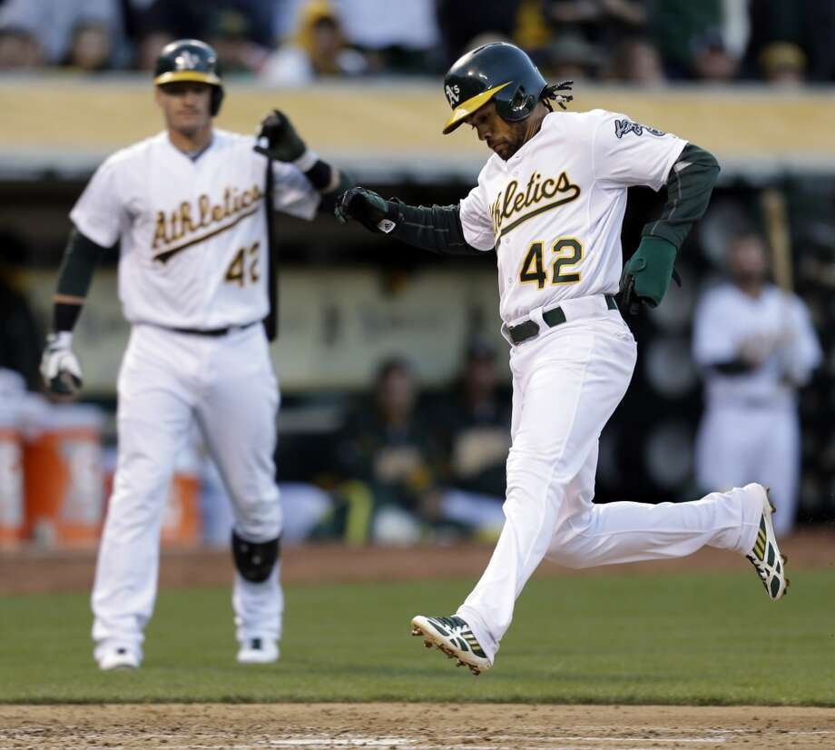 Coco Crisp, right, scores on a wild pitch. Photo: Ben Margot, Associated Press