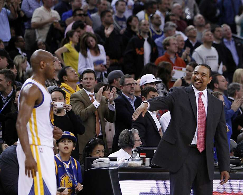 Warriors' head coach Mark Jackson jokes with Jarrett Jack (2) in the second half. The Golden State Warriors played the San Antonio Spurs at Oracle Arena in Oakland, Calif., on Monday, April 15, 2013. Photo: Carlos Avila Gonzalez, The Chronicle