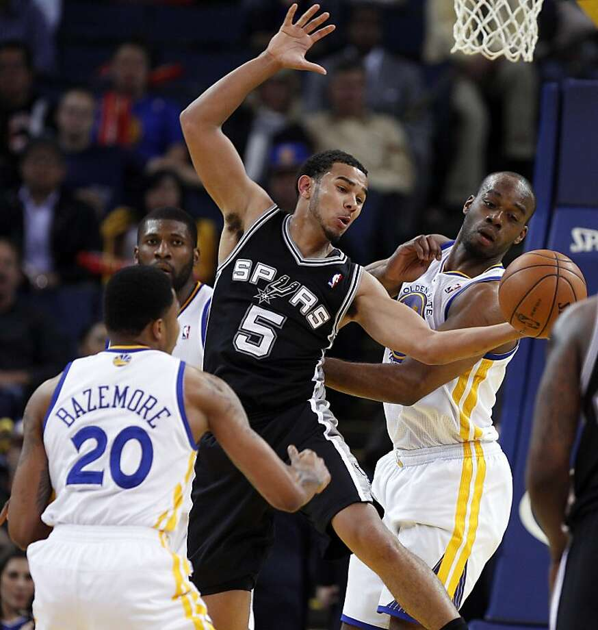 Cory Josephe (5) can't get a rebound in front of Carl Landry (7) in the second half. The Golden State Warriors played the San Antonio Spurs at Oracle Arena in Oakland, Calif., on Monday, April 15, 2013. Photo: Carlos Avila Gonzalez, The Chronicle