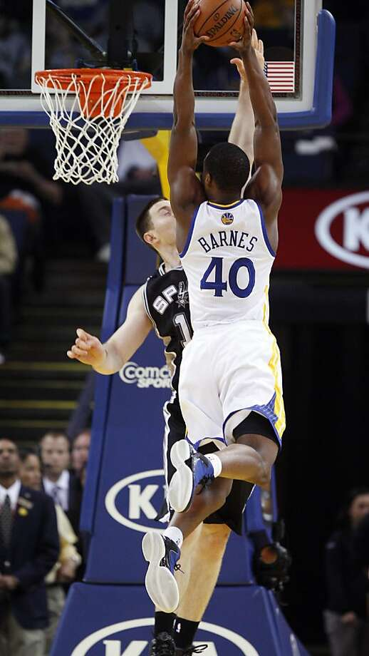Harrison Barnes (40) dunks over Aron Baynes (16) in the first half. The Golden State Warriors played the San Antonio Spurs at Oracle Arena in Oakland, Calif., on Monday, April 15, 2013. Photo: Carlos Avila Gonzalez, The Chronicle