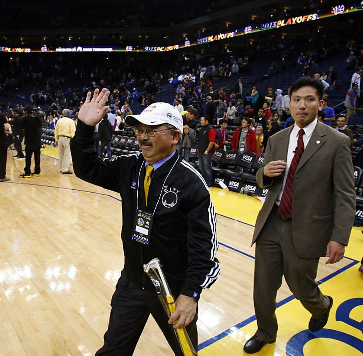 San Francisco Mayor Ed Lee waves to the crowd at Oracle Arena after the Warriors defeated the Spurs. The Golden State Warriors played the San Antonio Spurs at Oracle Arena in Oakland, Calif., on Monday, April 15, 2013.