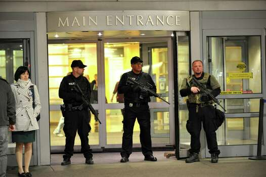 Armed police officers secure the main entrance to Bringham and Women's Hospital April 16, 2013 in Boston, Massachusetts. Many who were wounded when two explosions struck near the finish line of the Boston Marathon were brought to Bringham and Women's.  AFP PHOTO/Stan HONDA Photo: Getty Images