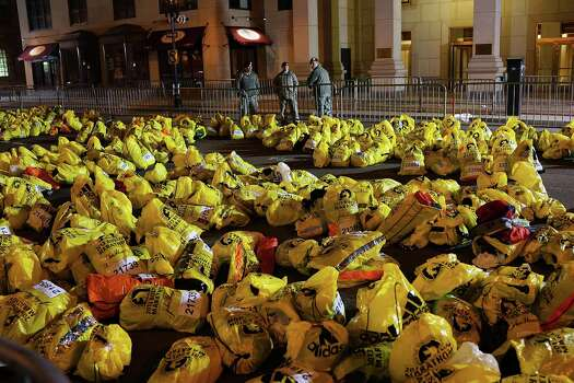 BOSTON, MA - APRIL 16:  Unclaimed finish line bags are viewed near the scene of a twin bombing at the Boston Marathon, on April 16, 2013 in Boston, Massachusetts. Three people are confirmed dead and at least 141 injured after the explosions went off near the finish line of the marathon yesterday. The bombings at the 116-year-old Boston race, resulted in heightened security across the nation with cancellations of many professional sporting events as authorities search for a motive to the violence. Photo: Spencer Platt, Getty Images / 2013 Getty Images