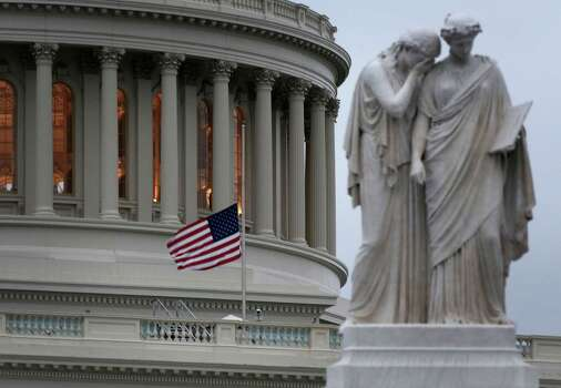 WASHINGTON, DC - APRIL 15:  A U.S. flag flies at half staff on the U.S. Capitol April 15, 2013 on Capitol Hill in Washington, DC. Speaker of the House Rep. John Boehner (R-OH) has ordered to lower the flags after two people were confirmed dead and at least 100 injured after at least two explosions went off near the finish line of the Boston Marathon. Photo: Alex Wong, Getty Images / 2013 Getty Images