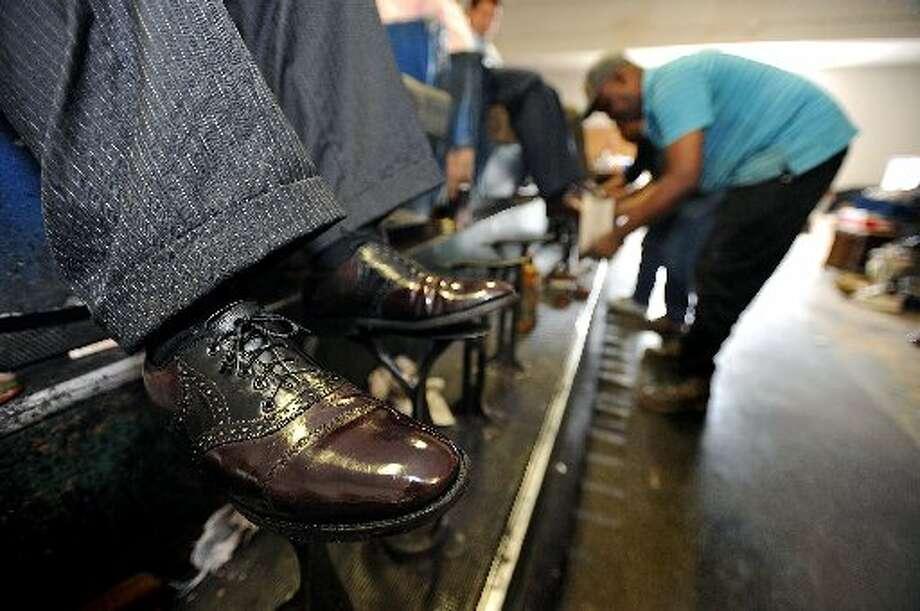 Joseph Ardoin shines shoes at Mirror Shine & Shoe Repair. Guiseppe Barranco/cat5