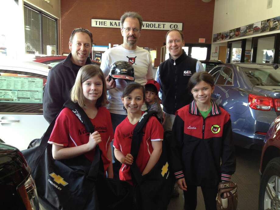 Karl Chevrolet of New Canaan is throwing its support behind New Canaan Baseball. In front row from left, Ingrid Weissman, Carolina Welch and  Leila Dann; back row, Jason Dolby, New Canaan Baseball's equipment manager; Tim Dann and Jack Dann;  and Steve Karl, vice president of Karl Chevrolet. Photo: Contributed