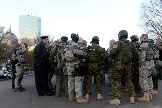 BOSTON, MA - APRIL 16: Swat team members and special police units assemble in the Boston Common on April 16, 2013 in Boston, Massachusetts. Security is especially tight in the city of Boston after two explosions went off near the finish of the Marathon, killing three people and injuring at least 141 others. Photo: Darren McCollester, Getty Images / 2013 Getty Images