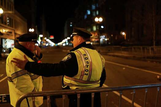 BOSTON, MA - APRIL 16: Boston Police stand near the scene of a twin bombing at the Boston Marathon, on April 16, 2013 in Boston, Massachusetts. Three people are confirmed dead and at least 141 injured after the explosions went off near the finish line of the marathon yesterday. The bombings at the 116-year-old Boston race, resulted in heightened security across the nation with cancellations of many professional sporting events as authorities search for a motive to the violence. Photo: Spencer Platt, Getty Images / 2013 Getty Images