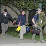 REVERE, MA - APRIL 15: Police and federal officials exit an apartment complex at 364 Ocean Avenue with a possible connection to the earlier expolsions during the Boston Marathon on April 15, 2013 in Revere, Massachusetts. Three people are confirmed dead and at least 141 injured after two explosions went off near the finish line to the marathon.