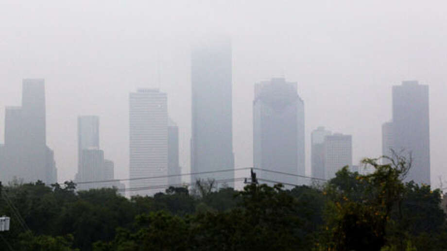 Fog hangs over the Houston skyline early Tuesday morning. Photo: Johnny Hanson / Houston Chronicle
