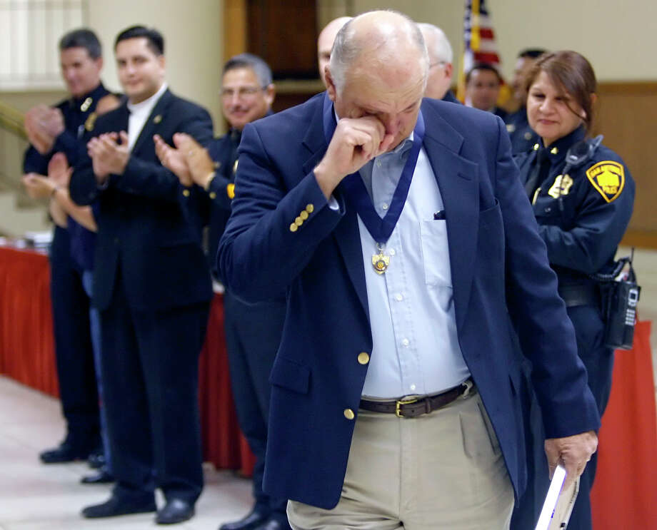 Retired officer James Middleton wipes a tear from his face Friday afternoon, Jan. 11, 2007, at Municipal Auditorium after receiving the San Antonio Police Department's Medal of Valor award, the department's highest honor, for his actions during the 1979 Fiesta Sniper shooting. Photo: WILLIAM LUTHER, SAN ANTONIO EXPRESS-NEWS / SAN ANTONIO EXPRESS-NEWS