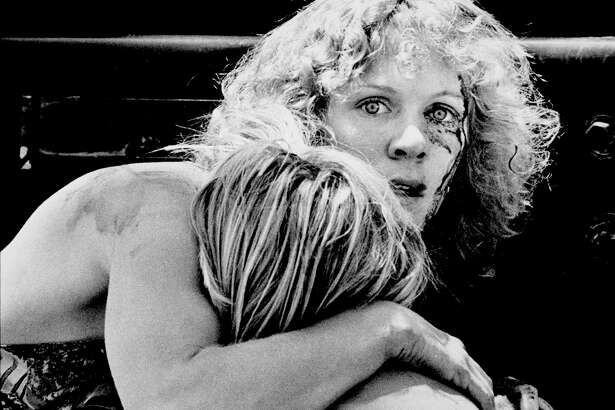 T.J. Lapping is comforted by his aunt Dianne Wick, while his mother, who was shot in the neck by Ira Attebury is treated nearny on Friday, April 27, 1979 in San Antonio, Texas. (Photo courtesy of the Institute of Texan Cultures)