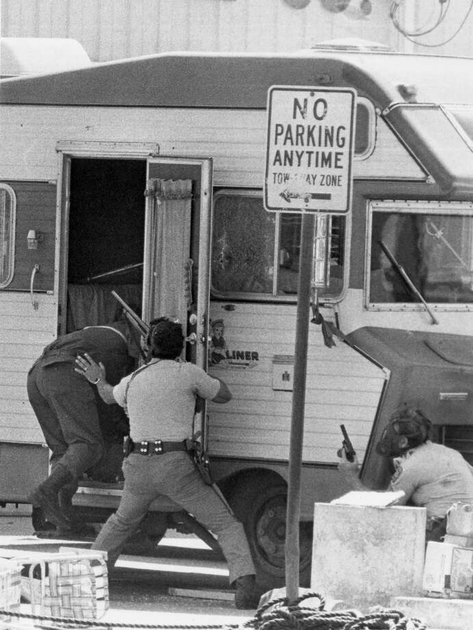 Local SWAT team members enter the vehicle of the sniper on Friday, April 27, 1979. Photo: Al Guzman, SAN ANTONIO LIGHT / LIGHT FILE PHOTO