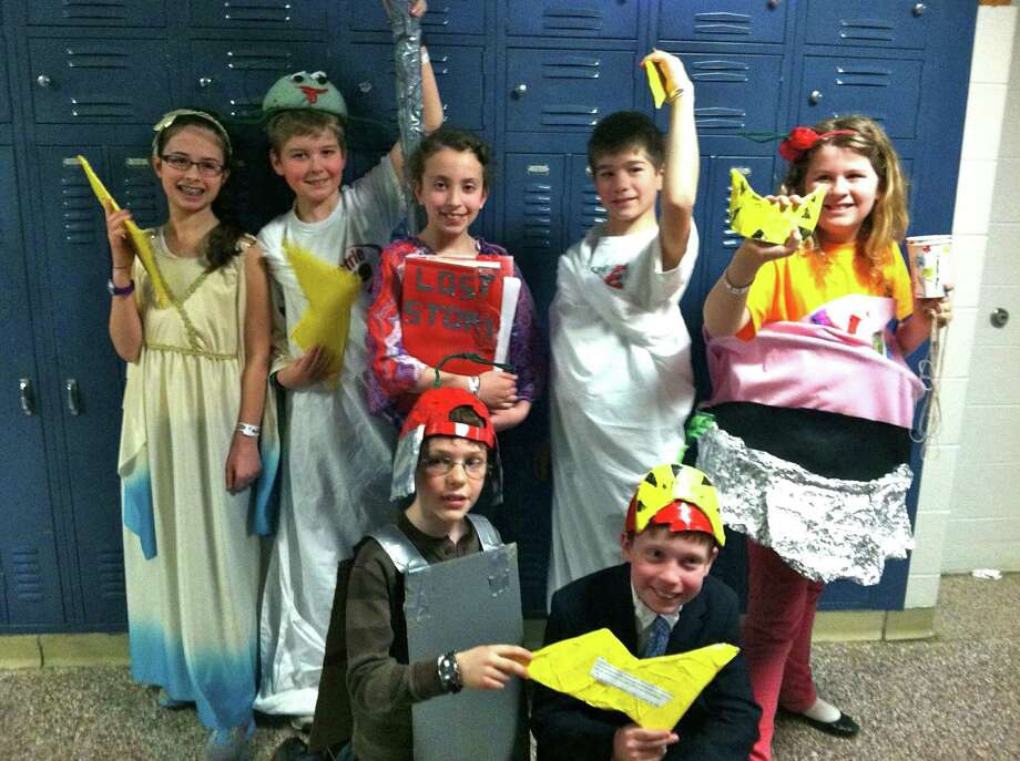 The Division I first-place fifth-grade team members in the Odyssey of the Mind competition are Andrew Morse, Jack Ellis, Allie Orphanos, Julia Sulkowski, Brian Campe, Skye Curren and Tyson Hammer. The team, and four others from New Canaan, will be competing in the World Finals in May. Photo: Contributed