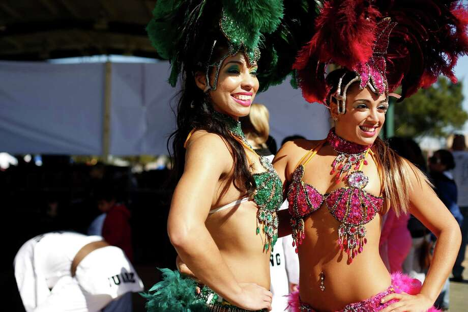 The Texas Lunar Festival in Alief celebrates the Lunar New Year while celebrating a variety of cultures, such as Brazilian culture as illustrated by these samba dancers. The 2014 festival is Saturday. Photo: TODD SPOTH, For The Chronicle / Todd Spoth
