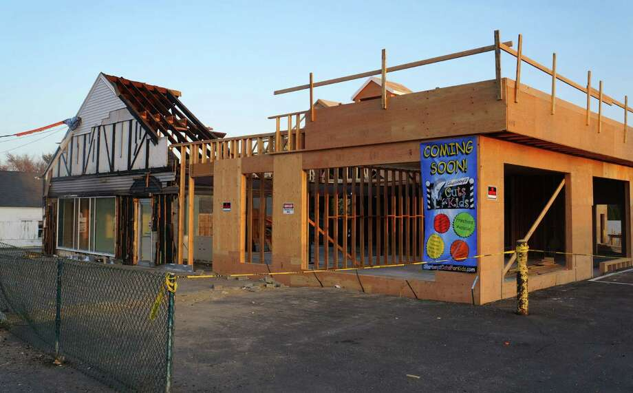 A view of the Sharkey's Cuts for Kids store under construction at 1572 Post Road East, the former site of Goodwill's Westport store. Sharkey's is scheduled to open at the site by August 3. Photo: Paul Schott / Westport News
