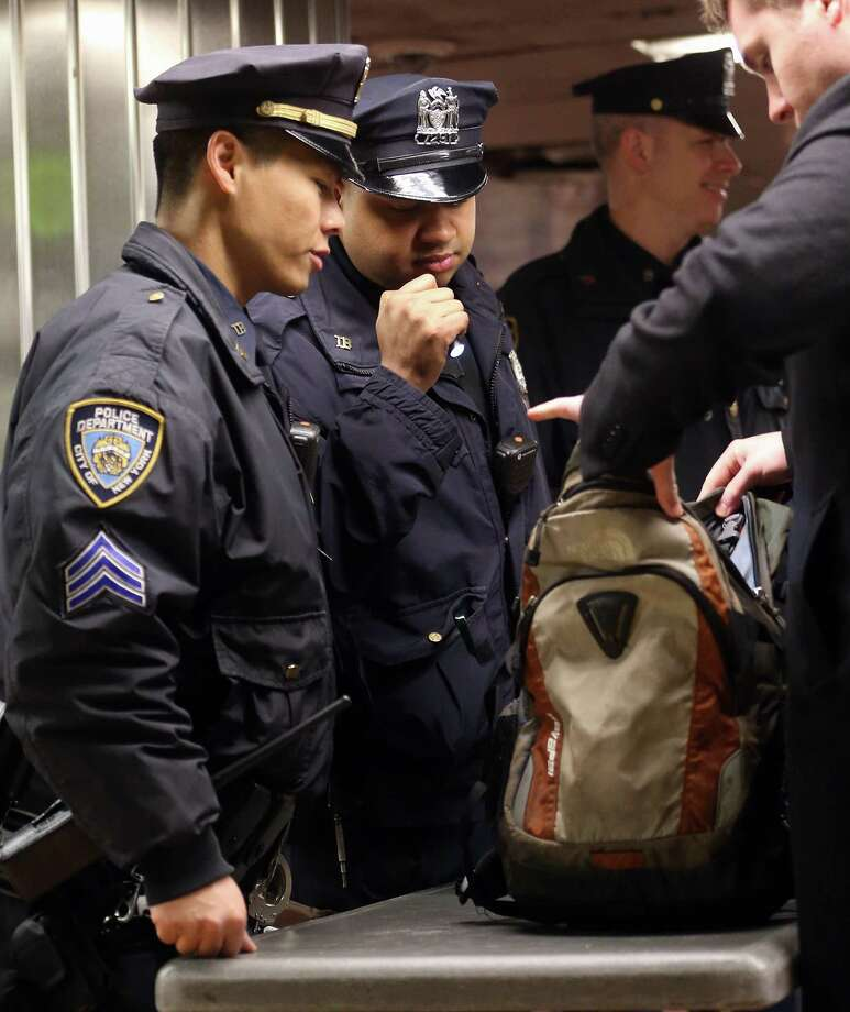 NEW YORK, NY - APRIL 16:  New York Police Department officers inspect bags at a subway entrance during the morning commute in Grand Central Terminal on April 16, 2013 in New York City.  The city announced it has continued increased security one day after the Boston Marathon bombings. Photo: Mario Tama, Getty Images / 2013 Getty Images