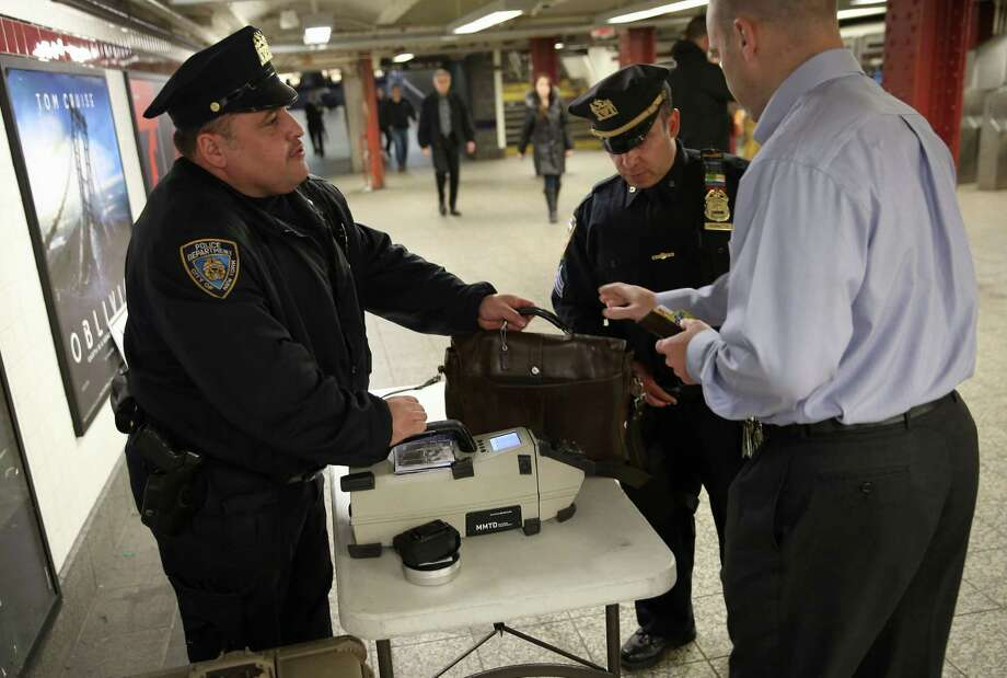 NEW YORK, NY - APRIL 16:  Police check a subway passenger's bag at Penn Station on April 16, 2013 in New York City. Police were out in force throughout New York, a day after explosions near the finish line of the Boston Marathon killed 3 people and wounded more than 170 others. Photo: John Moore, Getty Images / 2013 Getty Images