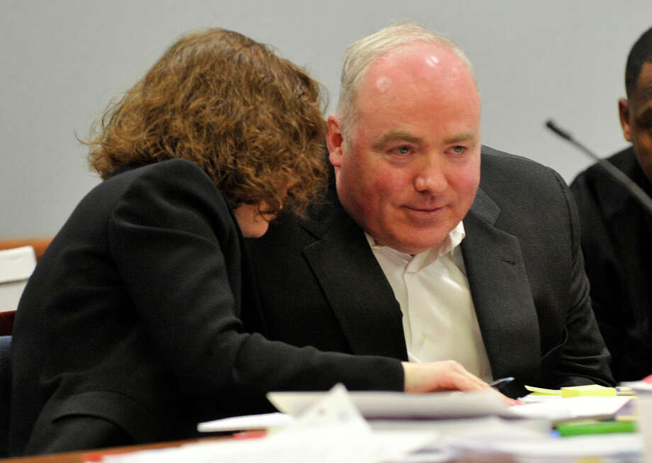 Defense attorney Jessica Santos, left, talks with her client, Michael Skakel, at Skakel's habeas corpus hearing at State Superior Court in Rockville, Conn., on Tuesday, April 16, 2013. Photo: Jason Rearick / Stamford Advocate