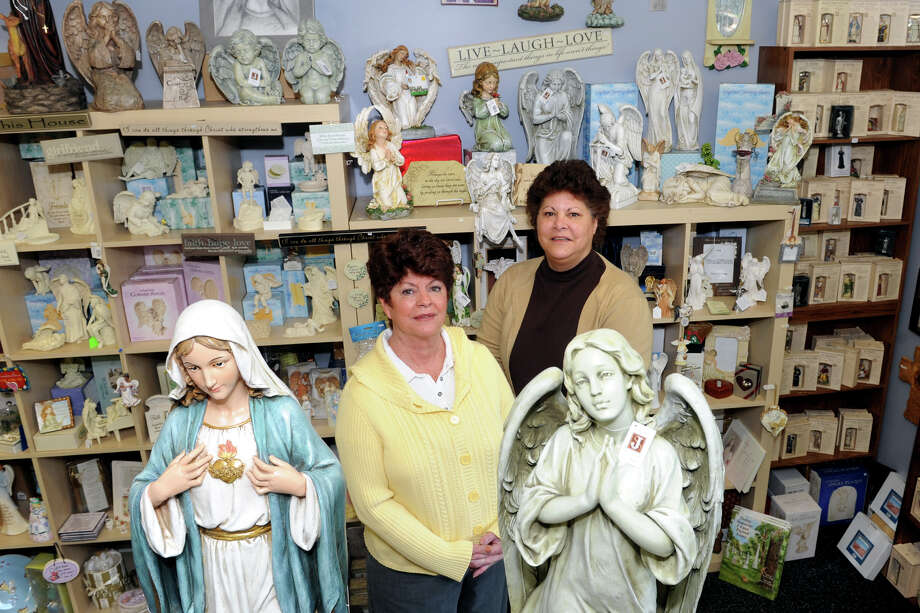 Midge Saglimbene and Linda Schirillo, owners of Angels & Company, a religious artifact store in Monroe, Conn., April 16th, 2013. Photo: Ned Gerard / Connecticut Post