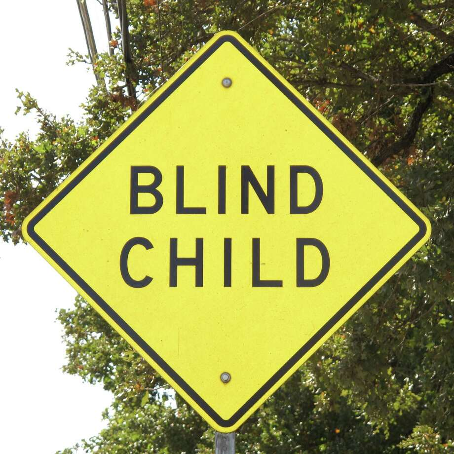 This Fort Worth street sign advises motorists that a blind child resides nearby. Photo: Forrest M. Mims III, For The Express-News / San Antonio Express-News