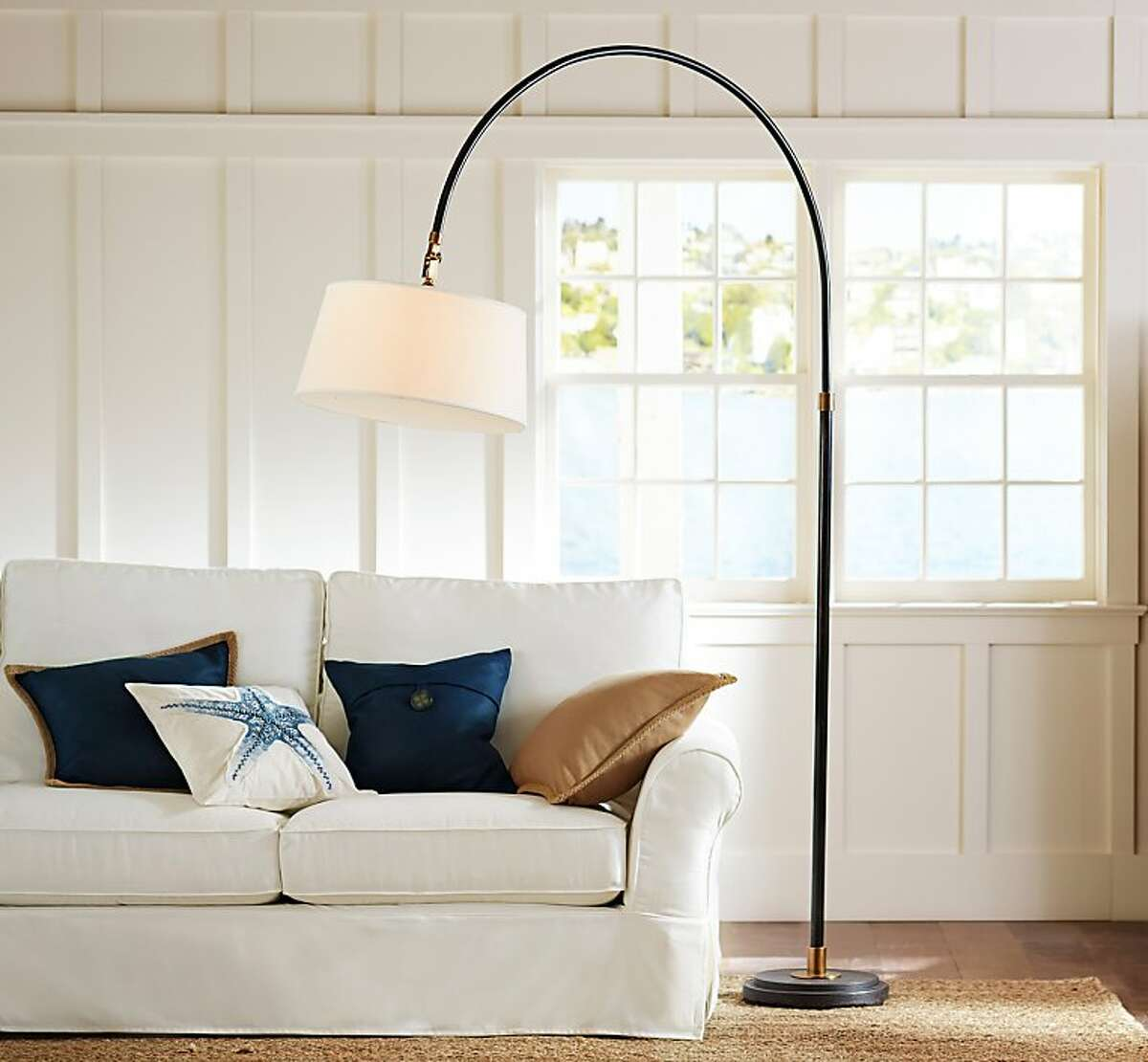 More: $434 to $459 Winslow Arc Section Floor Lamp www.potterybarn.com