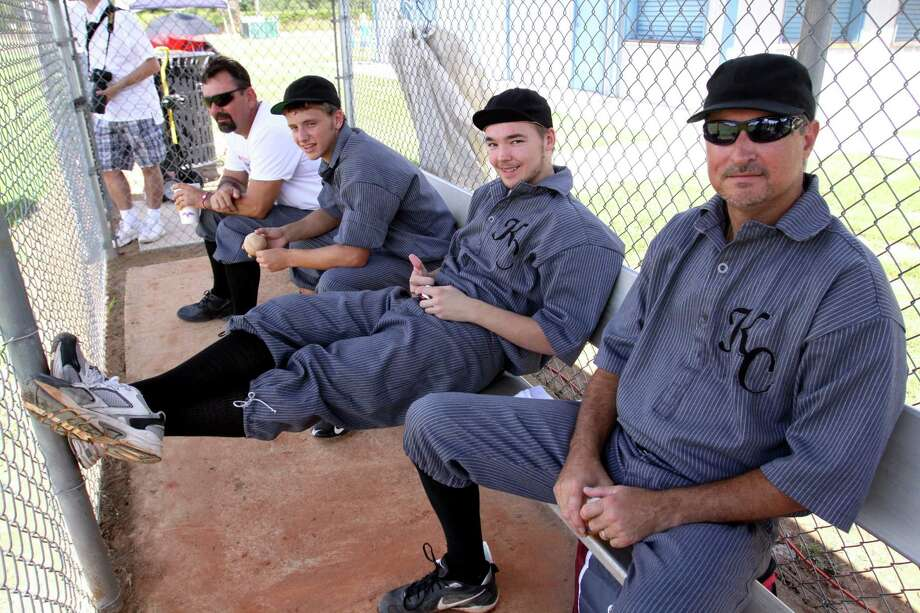 Members of the Katy Combines in the dugout, from left, are Roy Frankum, Harley Frankum, Eric Coovert and Jeff Roberts. Photo: Suzanne Rehak, Freelance Photographer