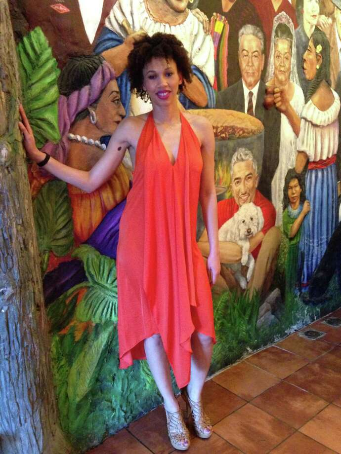 Tiffani Willis boldly goes where her vibrant orange BCBG Max Azria draped chiffon dress takes her: a party at Mi Tierra restaurant. The lightweight halter design with a plunging neckline is anchored with gladiator platform heels in a neutral hue, all the better to show off her colorful springtime look. Because she's swathed in a bright color, she can get away with no jewelry except for a black wide-band watch, a counterbalance to her soft, sexy style. - Michael Quintanilla Photo: Michael Quintanilla, San Antonio Express-News / Michael Quintanilla