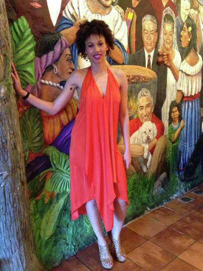 Tiffani Willis boldly goes where her vibrant orange BCBG Max Azria draped chiffon dress takes