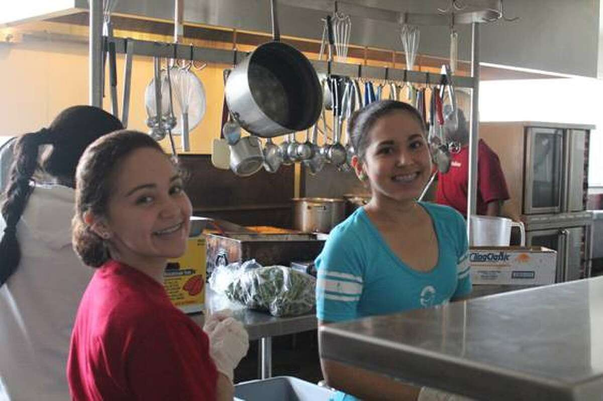 Celeste Pacheco and Mirasol Rangel in the cafeteria at Chinquapin Preparatory School, a nonprofit college-preparatory school in The Highlands.