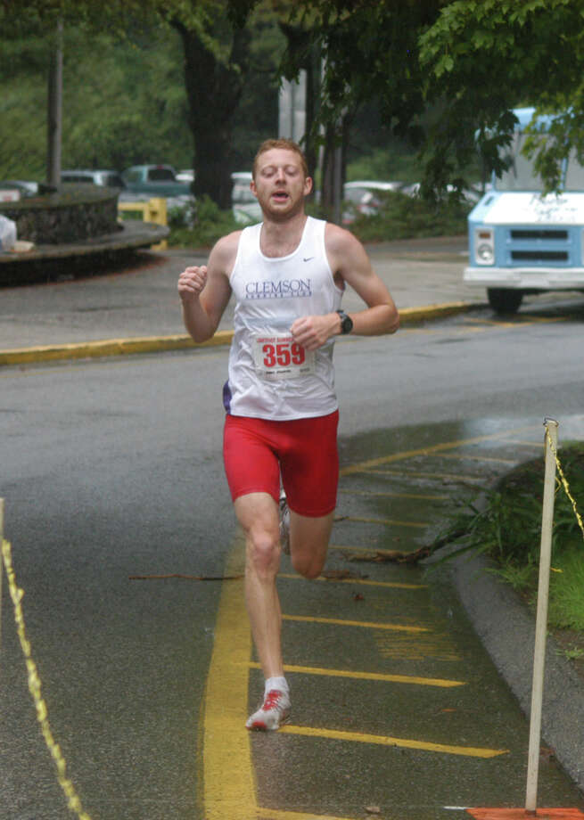 New Canaan's Nick Sykes had recently finished the Boston Marathon when the explosions occurred. Sykes won the Lightfoot Running Club's 11-mile race in a time of 1:05.58 in August of 2012. Photo: Andy Hutchison