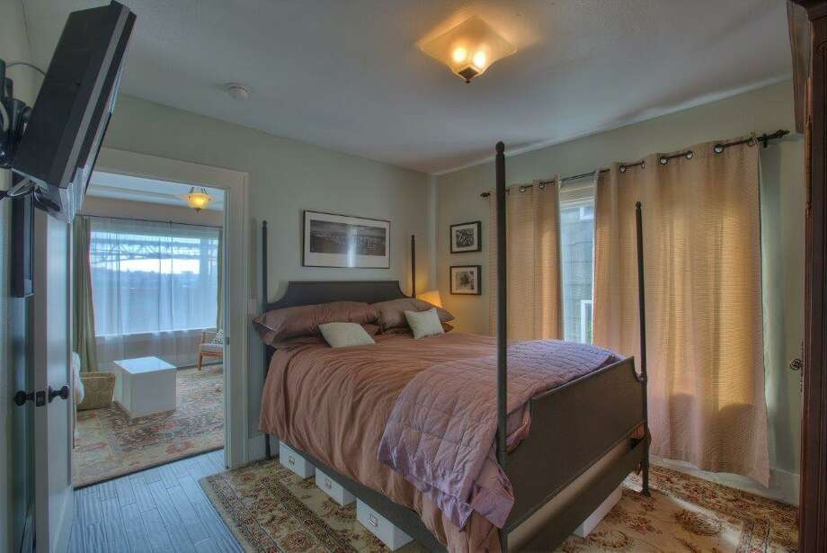 Bedroom of 3911 1st Ave. N.E. The 2,435-square-foot Craftsman, built in 1930, has four bedrooms, 1.75 bathrooms, a finished basement, a front porch and a back patio on a 4,000-square-foot lot. It's listed for $615,000. Photo: Courtesy Stacey Brower, Keller Williams Greater Seattle