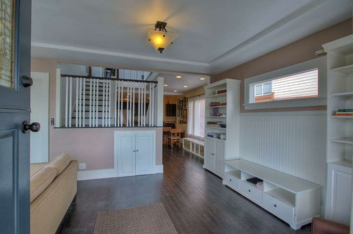 Entry of 3911 1st Ave. N.E. The 2,435-square-foot Craftsman, built in 1930, has four bedrooms, 1.75 bathrooms, a finished basement, a front porch and a back patio on a 4,000-square-foot lot. It's listed for $615,000.