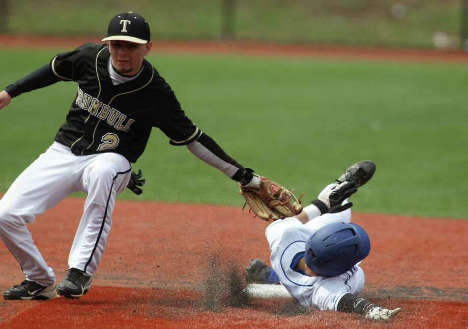 Brendan Donahue of Darien successfully steals second base under the tag of Trumbull's James DeNomme during baseball action in Darien on Monday. Trumbull won the game, 5-0.© J. Gregory Raymond Photo: J. Gregory Raymond / Stamford Advocate Freelance;  © J. Gregory Raymond