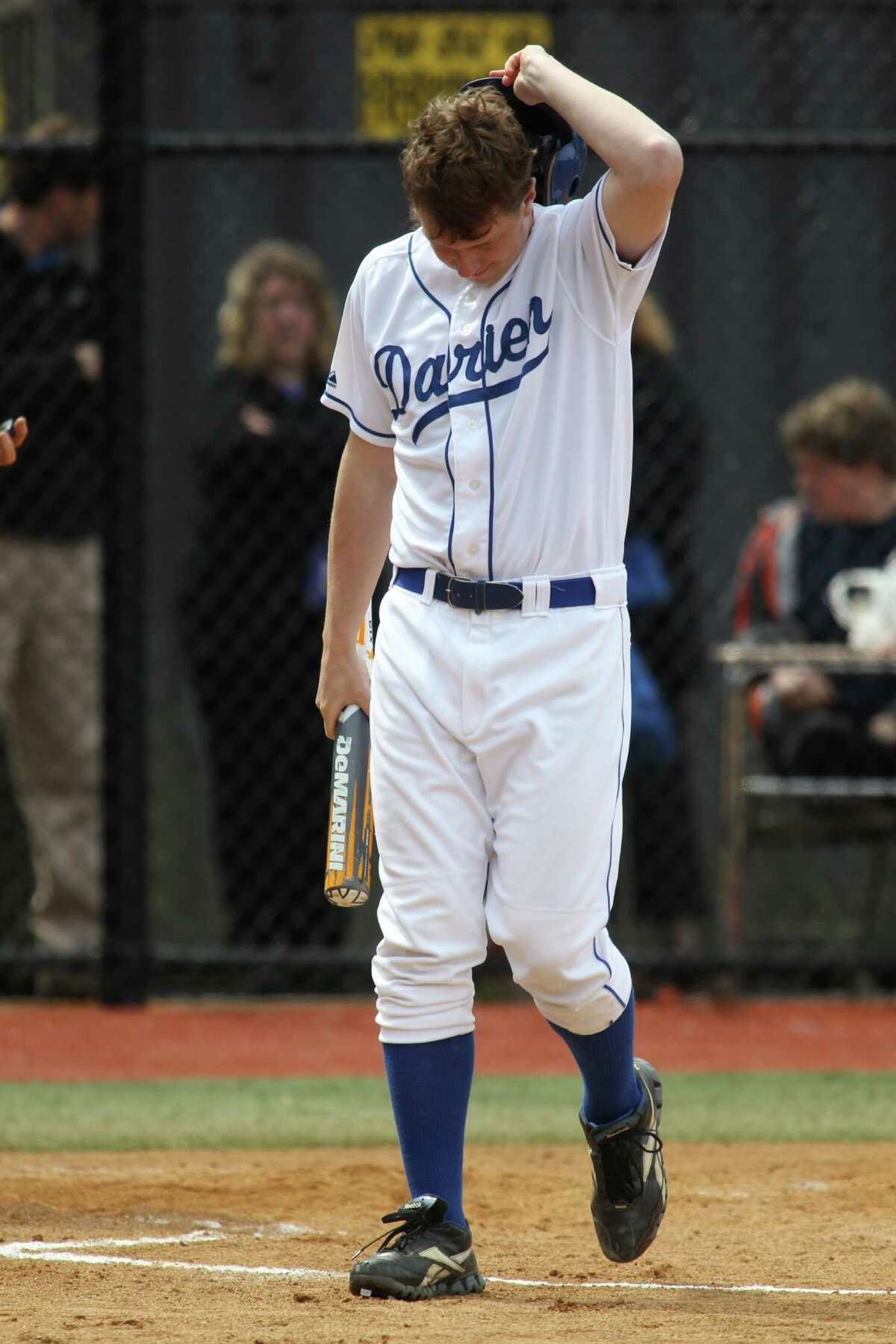 Darien's Liam Naughton shows his dejection following his strikeout against Trumbull on Monday. The visiting Eagles won the game, 5-0. © J. Gregory Raymond