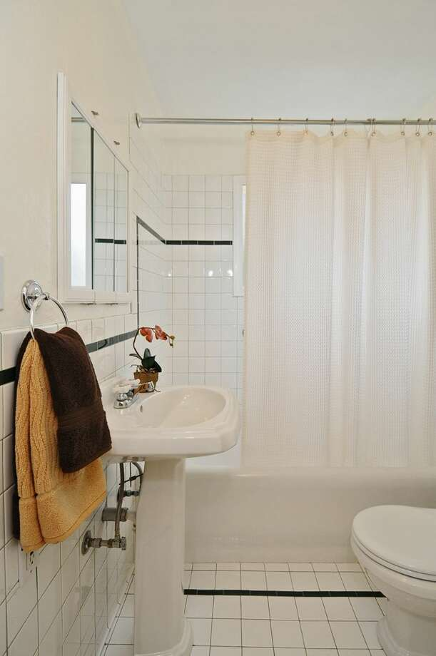 Bathroom of 2109 N. 39th St. The 2,220-square-foot house, built in 1924, and later added onto, has four bedrooms, two bathrooms, built-ins, a finished basement and a patio on a 1,1817-square-foot lot. It's listed for $625,000. Photo: Courtesy Russ Katz, Windermere Real Estate