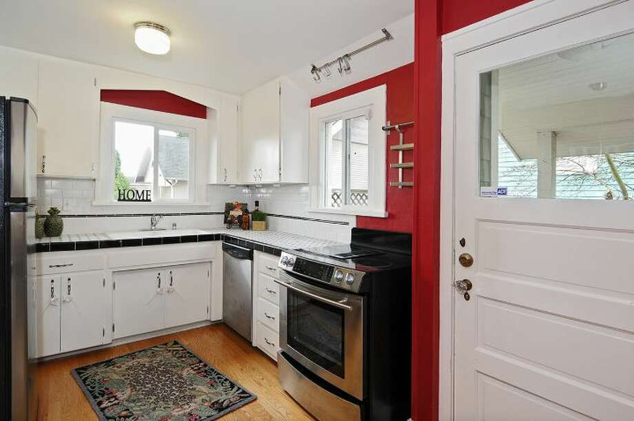 Kitchen of 2109 N. 39th St. The 2,220-square-foot house, built in 1924, and later added onto, has four bedrooms, two bathrooms, built-ins, a finished basement and a patio on a 1,1817-square-foot lot. It's listed for $625,000. Photo: Courtesy Russ Katz, Windermere Real Estate