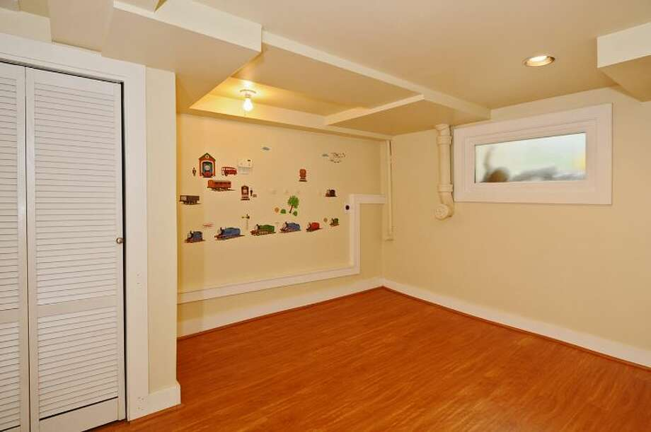 Basement of 2109 N. 39th St. The 2,220-square-foot house, built in 1924, and later added onto, has four bedrooms, two bathrooms, built-ins and a patio on a 1,1817-square-foot lot. It's listed for $625,000. Photo: Courtesy Russ Katz, Windermere Real Estate