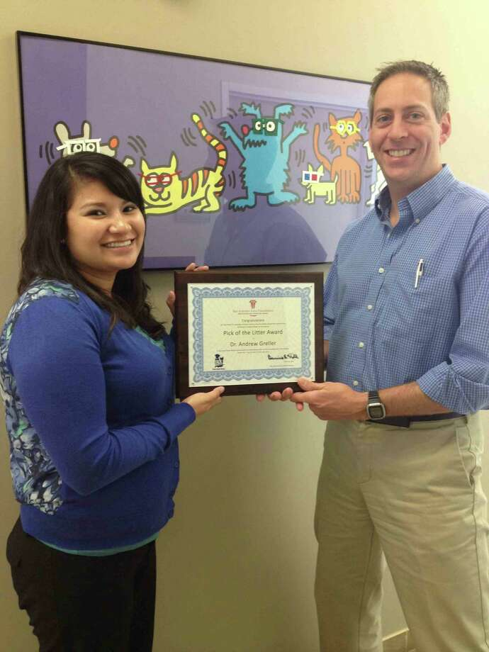 Nicole Beltran, intern with the Talk About It! program, poses with Dr. Andrew Greller upon his recognition in the San Antonio Area Foundation/Talk About It! Pick of the Litter Contest. Photo: Courtesy Photo